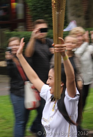 ARMS IN THE AIR LIKE SHE JUST DON'T CARE: Torchbearer Number 130 runs through Oxford yesterday, in the final leg of its Luton to Oxford journey. (IMG_8533)