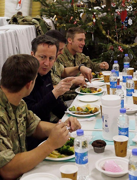 DINNER WITH THE LADS: David Cameron enjoying Christmas dinner with British troops earlier this week. (SNN21042GA---_1641600a)