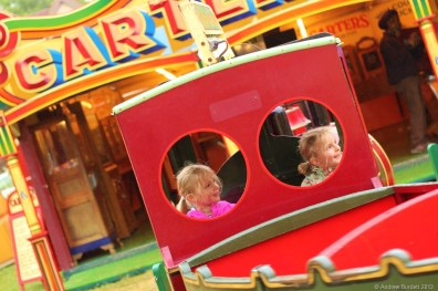 A TRAIN FOR TWO: Two girls have the Marlow Donkey baby train ride to themselves.