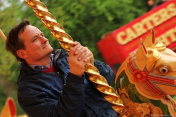 HORSEY BOY: Father enjoys a traditional ride on the Steam Gallopers.
