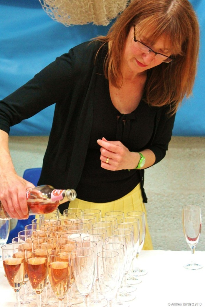 ALL THOSE GLASSES? POUR HER!: This volunteer helped with the mammoth task of preparing the refreshments.