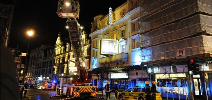 A night scene on a shut road in London's West End, in the aftermath of the partial theatre-collapse.