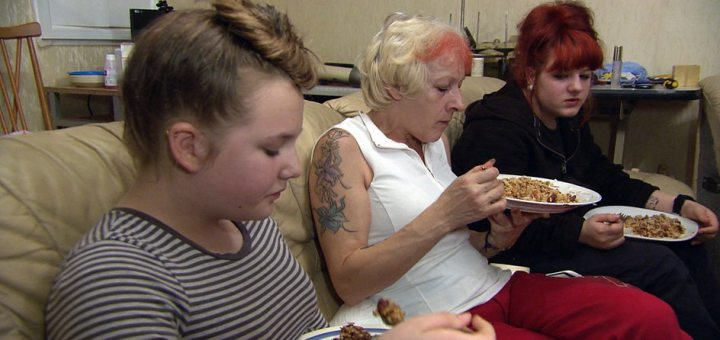 A widow and her two daughters eat a meal Rachel Johnson has prepared.