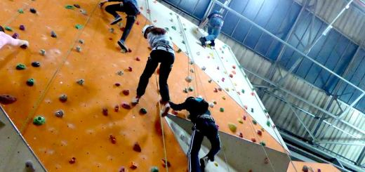 Four youngsters scale the fourteen-metre wall at Reading Climbing Centre, including (far right) Andrew Burdett.