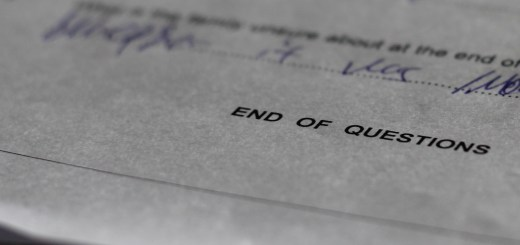 "An exams paper with the words ""End of Questions"" visible."