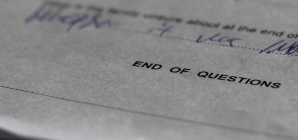 """An exams paper with the words """"End of Questions"""" visible."""