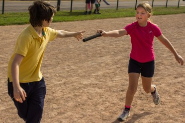 The baton passes from one Scout to another.