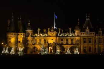 Seen here from an angle, the facade at Waddesdon is particularly impressive by night.