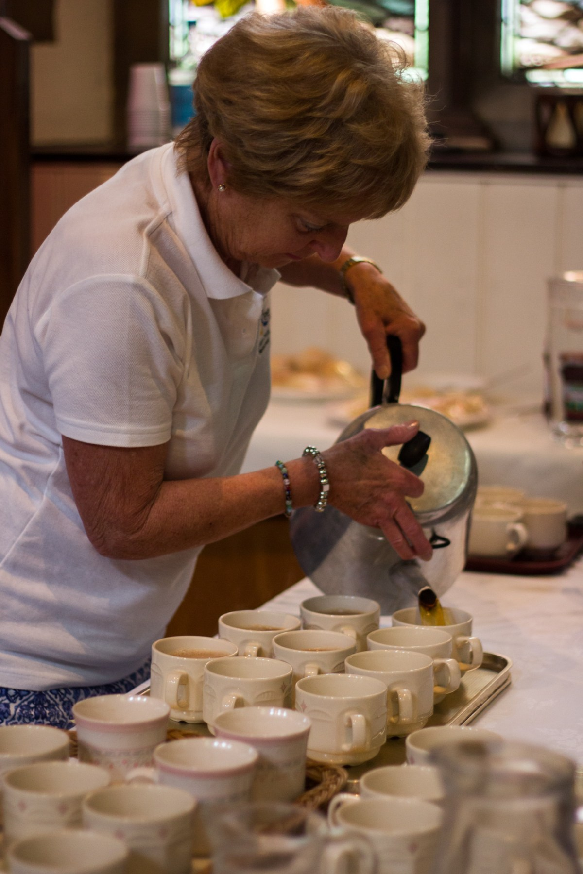 Doing a sterling job, Sally Somerville poured tea for audience-members to enjoy.