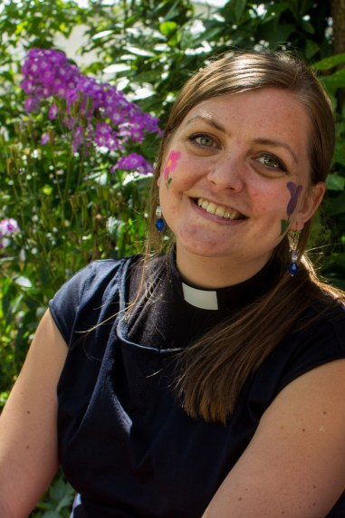 Nicola Hulks, the newly-installed St Luke's curate, had a floral design applied on Ruth Baughan's face-painting stall.