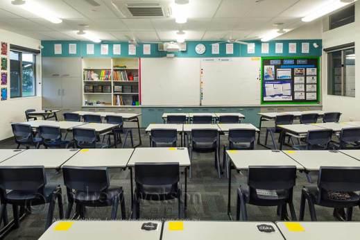 Image of school desks in an empty classroom