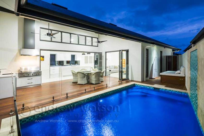 Exterior image of pool and outdoor dining area in residential home