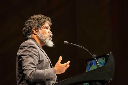 """Image of """"Welcome to Country"""" speaker during plenary sessions of ANZSGM 2016"""