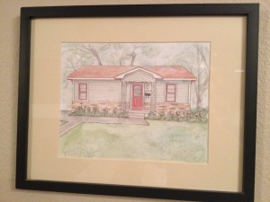 A photo of an artist's rendition of our first house.