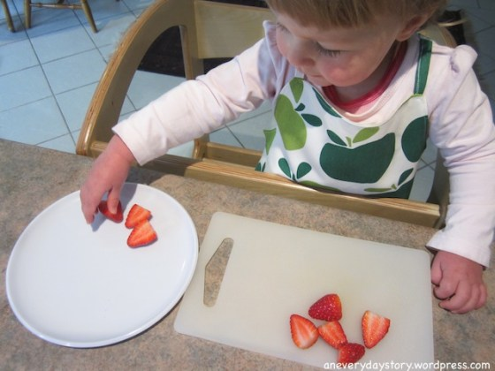 montessori pratical life in the kitchen preparing a snack young toddler using learning tower In the Kitchen with Sarah (and a teeny tiny apron)
