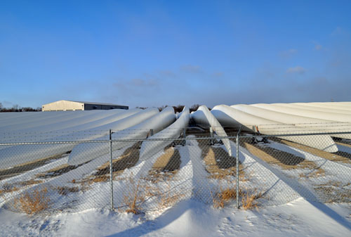 Windmill blades lying in snow drifts