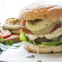 Parmesan Crusted Burgers with Grilled Onions and Tomatoes