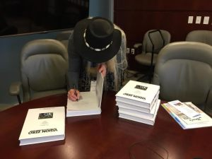 Marianne signing Vision Zero Petition Books at DOT