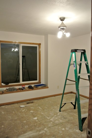Progress Day 4: One coat of paint+primer on the ceiling. Tyler rolled and I cut in. Team effort!