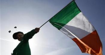 A boy holds a Republic of Ireland flag