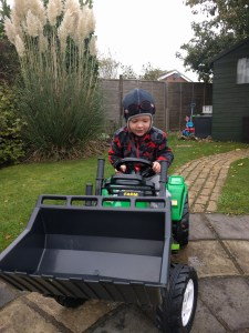 Getting outside to play with his new tractor