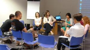 Researchers discussing ideas for social media use in academia. Photo by Clara Howcroft.