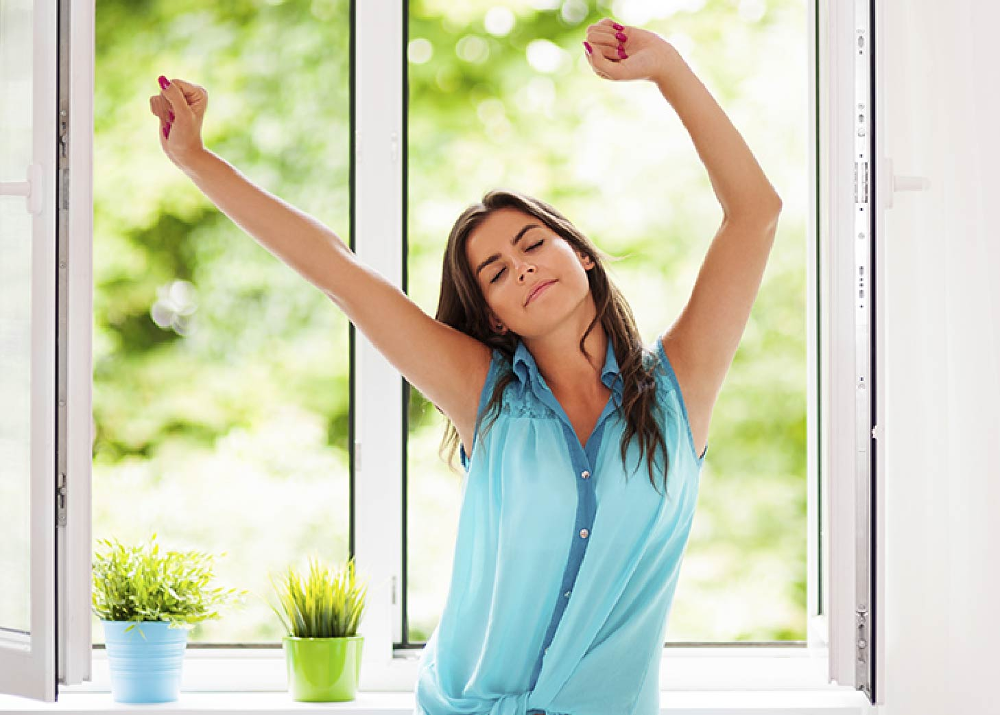 Woman in blue shirt stretching for fresh air