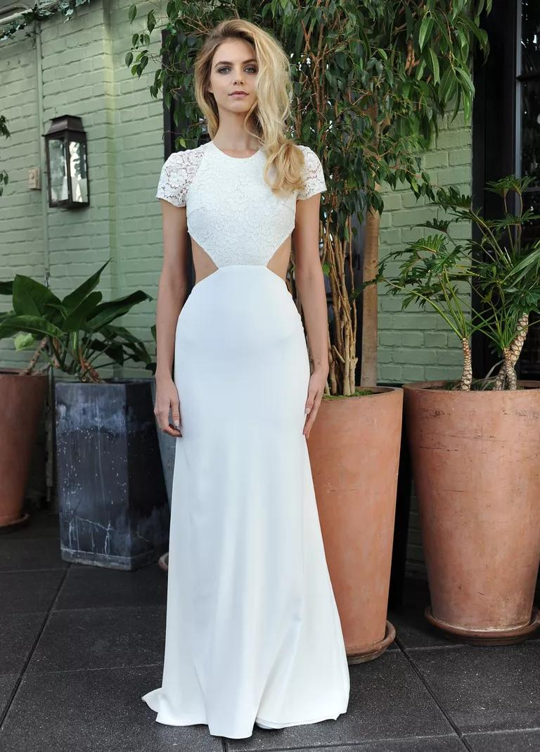 sarah seven wedding dresses bridal fashion week fall lace flowy wedding dress Sarah Seven wedding dress with lace bodice and short sleeves cutout waistline and white skirt