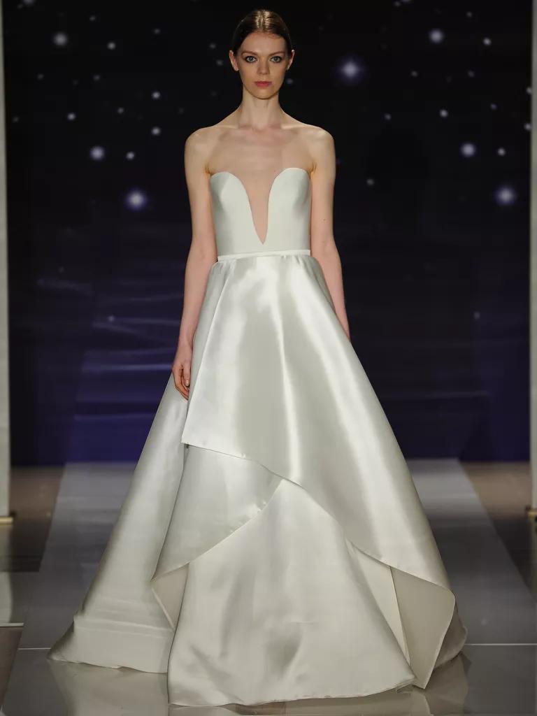 reem acra wedding dresses bridal fashion week spring plunge wedding dress Reem Acra strapless silk crepe plunge neck ballgown wedding dress with layered gazaar skirt detail