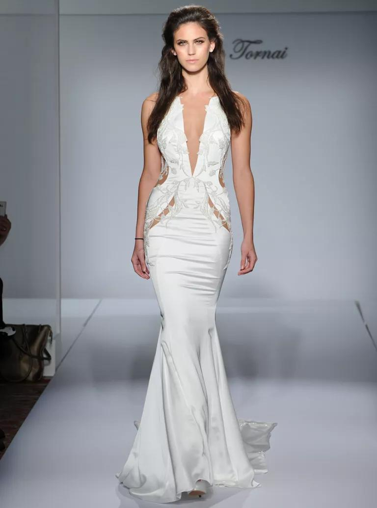 pnina tornai wedding dresses bridal fashion week fall sheer wedding dresses Pnina Tornai sexy mermaid wedding dress with sheer waist cutouts and plunging v neckline from
