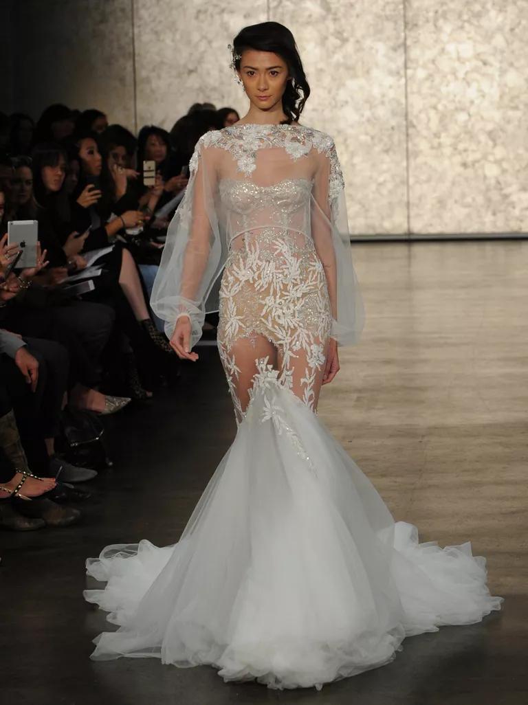 inbal dror wedding dresses bridal fashion week fall bell sleeve wedding dress Inbal Dror Fall silver lace strapless mermaid wedding dress with bell sleeve beaded shrug