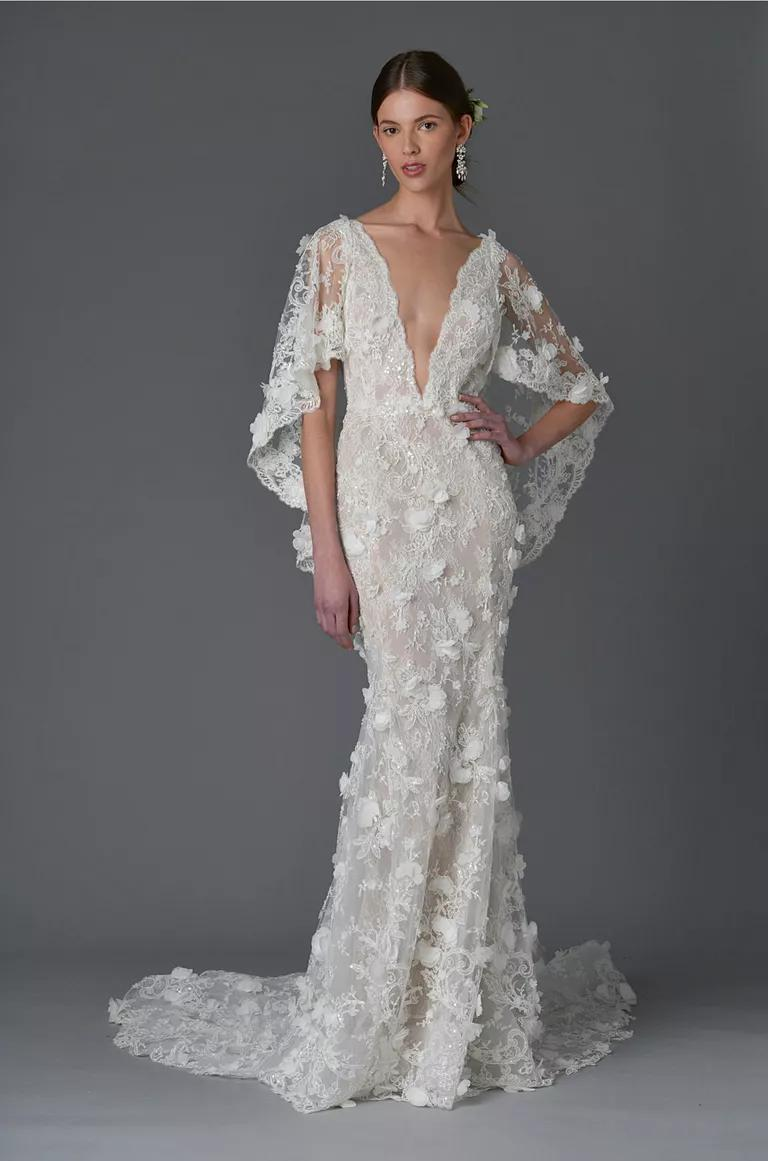 marchesa wedding dresses bridal fashion week spring marchesa wedding dress Marchesa Spring sheath wedding dress with plunging neckline and floral and lace embroidered cape