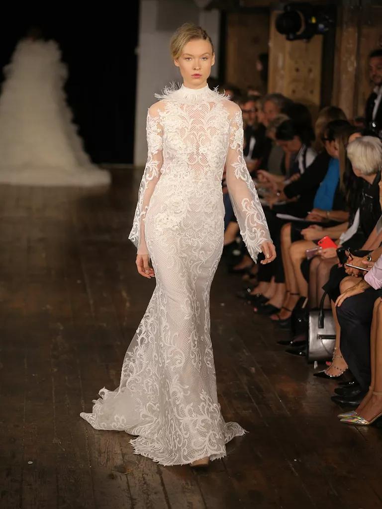 rivini wedding dresses bridal fashion week fall bell sleeve wedding dress Rivini Fall bell sleeve fit and flare feathered collar wedding dress