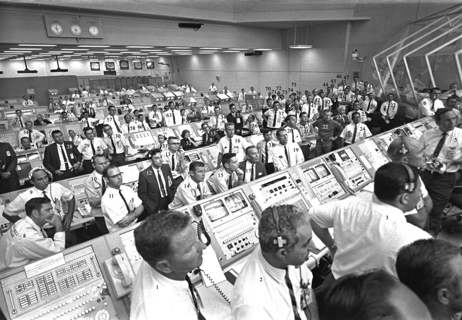 108-KSC-69P-631 Apollo 11 personnel listening to VIP remarks post launch