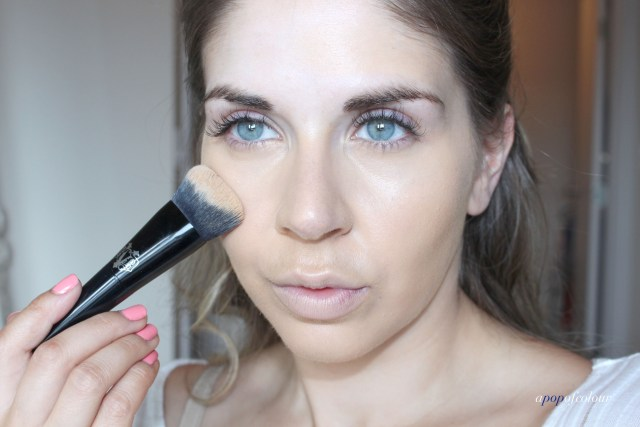 Applying foundation with brush