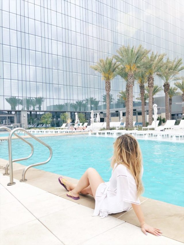 Sitting at the Fairmont Austin pool