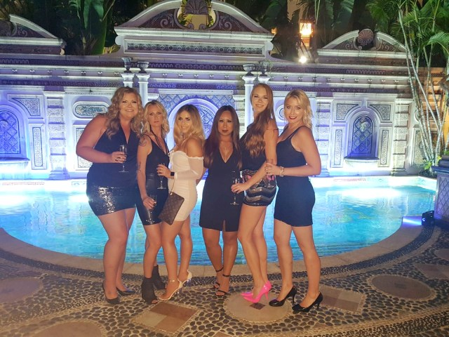 Group of girls at the Versace Mansion, Casa Casuarina Miami
