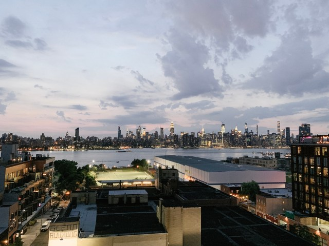 View of New York City from hotel rooftop bar in Brooklyn