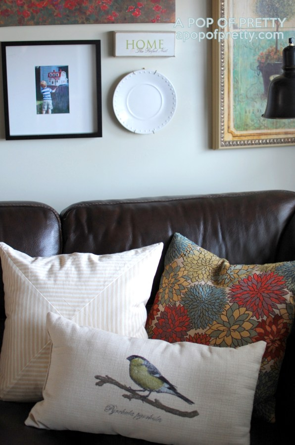 art wall over a sectional sofa