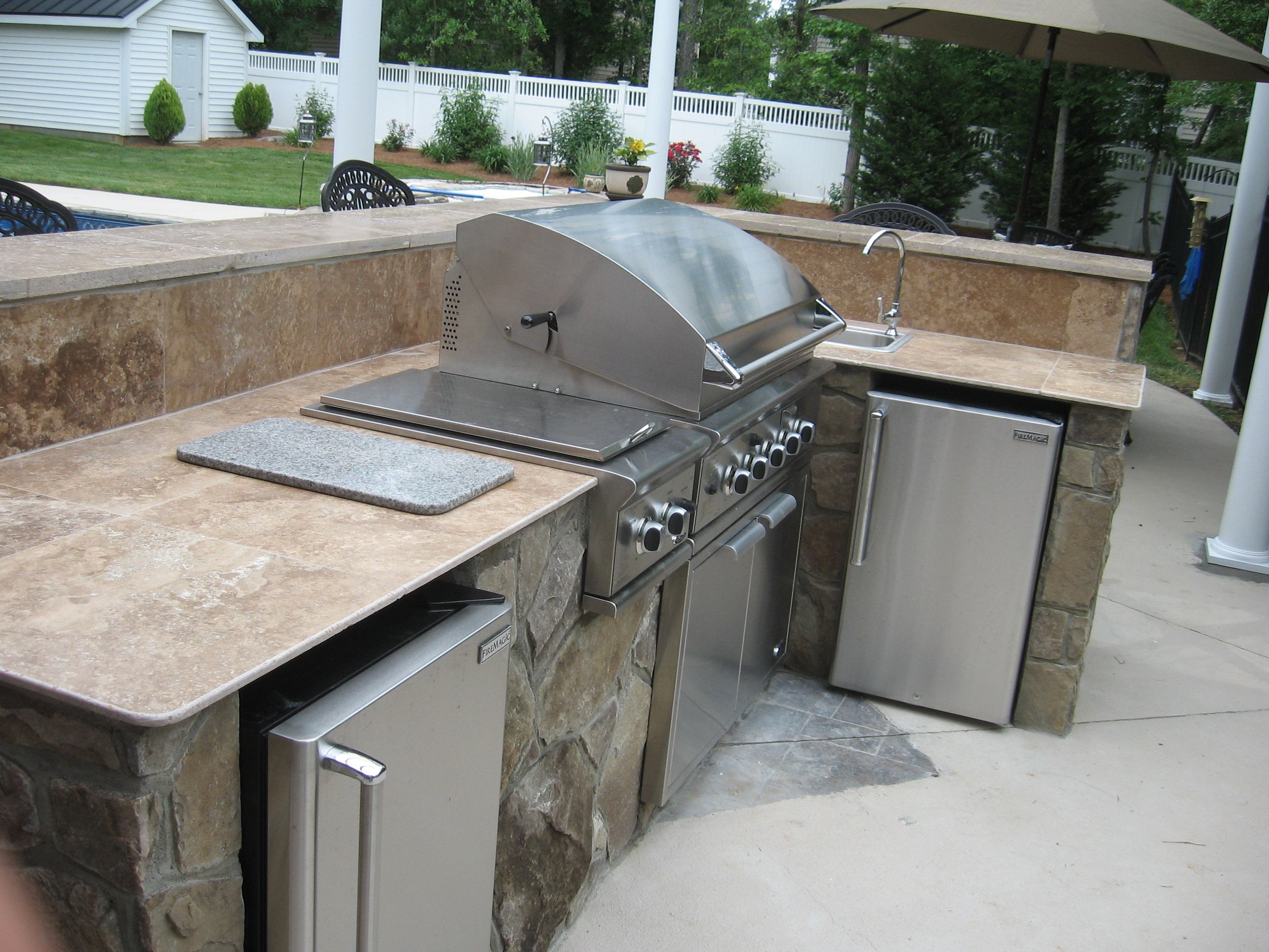 charlotte outdoor kitchens really taking off why outdoor kitchen countertops stone outdoor kitchen Charlotte with travertine countertop