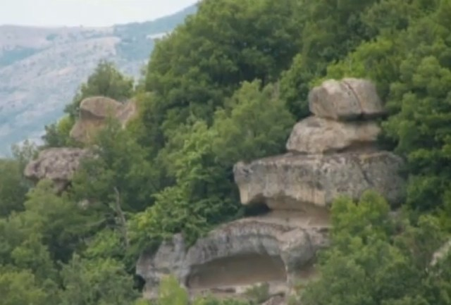 A side view of the Thracian rock pyramid, with the sun temple visible at its base. Photo: TV grab from BNT 2