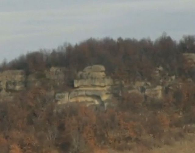 The newly found Thracian rock step pyramid was hacked into a rocky plateau - here viewed from a distance. Photo: TV grab from BNT 2