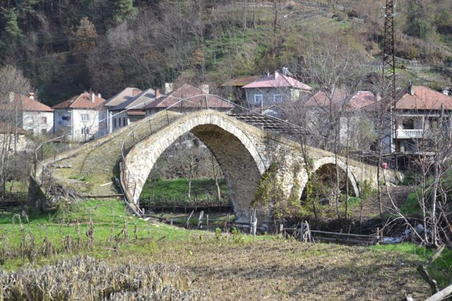 This 2014 photo shows the second Ancient Roman bridge in the town of Drangovo, the one located inside its populated area, and is still used daily by its residents. This bridge has also been damaged by treasure hunters removing stones from its structures, and it is visible how it was modified after some of its arches collapsed as a result of the treasure hunting raids. Photo: Perperikon.info