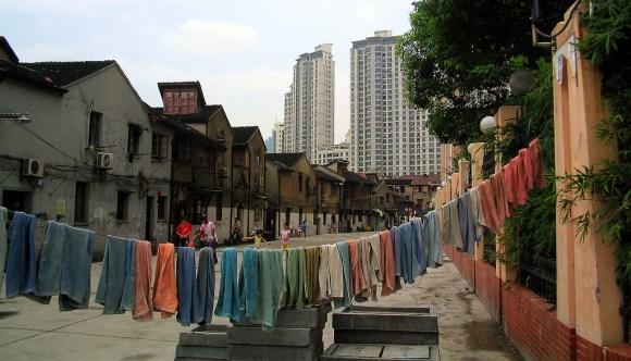 multi colored towel drying on line in low income residential street