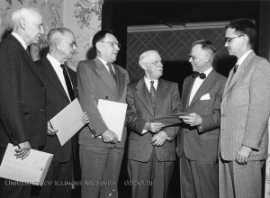 Photo of Thomas Clark Shedd (second from right), ca. 1955. Found in Record Series 39/2/20.