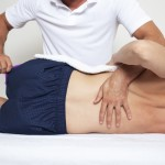 Therapist treating a patient with back pain