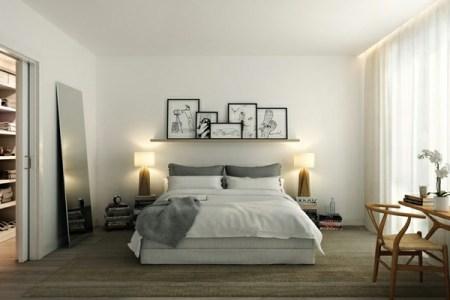 kleines schlafzimmer einrichten zwei lampen und bilder an der wand
