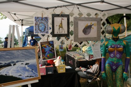 Our booth at the art show. Some of artist Chris Mendez's work can be seen here, along with work by other artists.