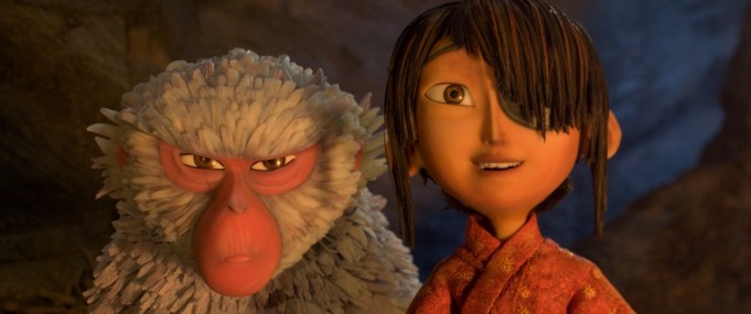 (l-r.) Monkey (voiced by Academy Award winner Charlize Theron) situates herself protectively alongside Kubo (Art Parkinson) in animation studio LAIKA's epic actionadventure KUBO AND THE TWO STRINGS, a Focus Features release.
