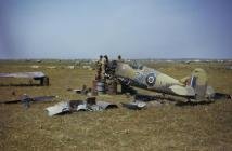 An Advanced Servicing Unit dismantles Supermarine Spitfire Mark IX, EN459 'ZX-1', of the Polish Fighting Team, attached to No 145 Squadron, RAF in Tunisia. The aircraft was damaged on 6 April 1943 when, after shooting down a Messerschmitt Bf 109, it was attacked by another Bf 109 and hit in the engine. The pilot, Flight Lieutenant Eugeniusz Horbaczewski, was able to glide in to Gabes for a forced landing.